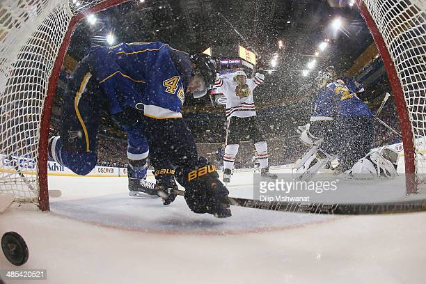 Kris Versteeg of the Chicago Blackhawks celebrates his goal as David Backes of the St Louis Blues falls into the goal in Game One of the First Round...