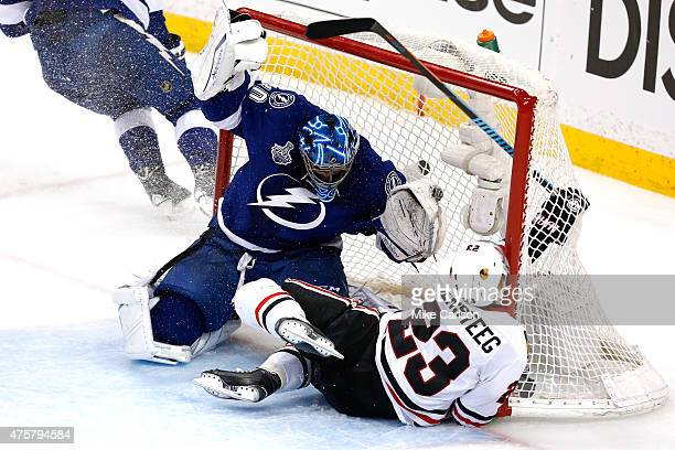 Kris Versteeg of the Chicago Blackhawks crashes into the net against Ben Bishop of the Tampa Bay Lightning during Game One of the 2015 NHL Stanley...
