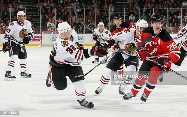 Kris Versteeg of the Chicago Blackhawks fires the puck for the game tying goal past Patrik Elias of the New Jersey Devils with 26 seconds left in the...