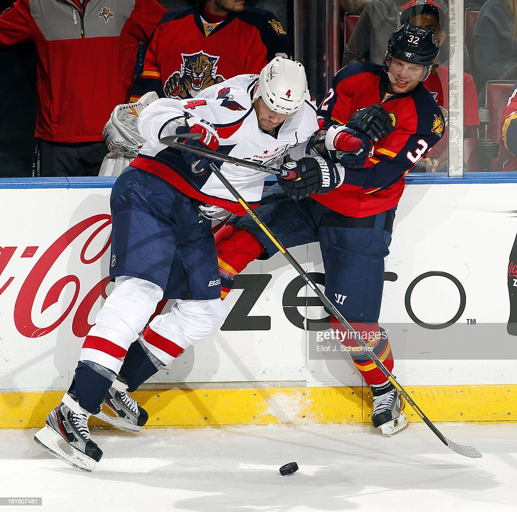 Kris Versteeg #32 of the Florida Panthers tangles with John Erskine #4 of the Washington Capitals at the BB&T Center on February 12, 2013 in Sunrise, Florida.