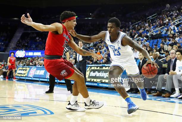Kris Wilkes of the UCLA Bruins dribbles against Elijah Cuffee of the Liberty Flames during the second half at Pauley Pavilion on December 29 2018 in...