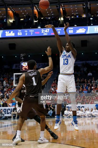 Kris Wilkes of the UCLA Bruins shoots the ball over the defense of Idris Taqqee of the St Bonaventure Bonnies during the game at UD Arena on March 13...