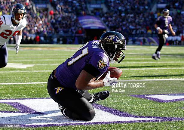 Kris Wilson of the Baltimore Ravens scores a touchdown in the first quarter against the Houston Texans during the AFC Divisional playoff at MT Bank...