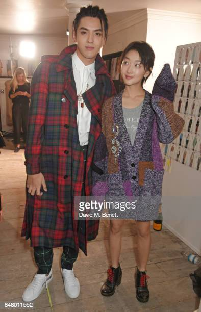 Kris Wu and Zhou Dongyu wearing Burberry at the Burberry September 2017 at London Fashion Week at The Old Sessions House on September 16 2017 in...