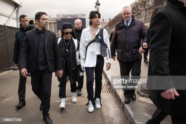 Kris Wu is seen attending Louis Vuitton during Men's Paris Fashion Week AW19 wearing white shirt with Louis Vuitton harness bag on January 17 2019 in...