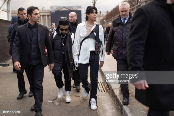 Kris Wu is seen attending Louis Vuitton during Men's Paris Fashion Week AW19 wearing white shirt with Louis Vuitton harness bag on January 17, 2019...