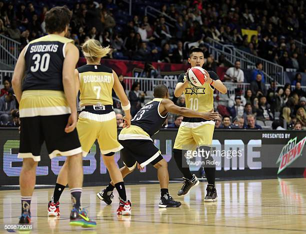 Kris Wu of Team Canada passes the ball during the NBA AllStar Celebrity Game against Team USA at the Ricoh Coliseum on February 12 2016 in Toronto...