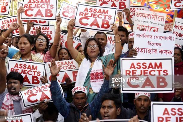 Krishak Mukti Sangram Samiti members shout slogan and hold placard as the protest against the Citizenship Amendment Bill 2016 in Guwahati, Assam,...