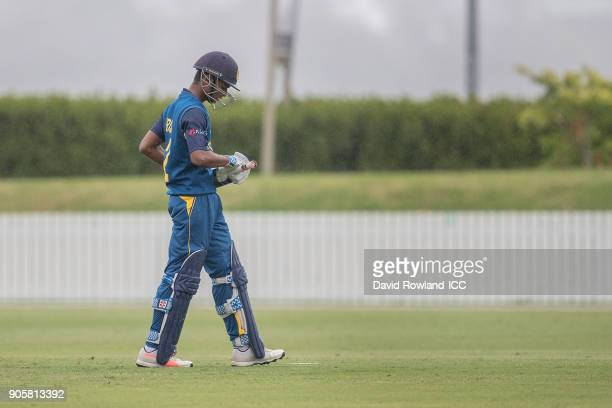 Krishan Sanjula of Sri Lanka walks off after being caught by Baheer Shah of Afghanistan off the bowling of Qais Ahmad of Afghanistan during the ICC...