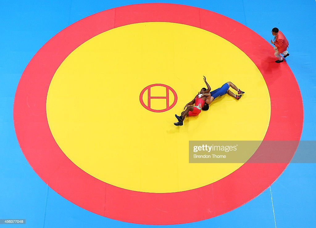 Krishankant Yadav of India competes with Saeid Abdvali of Iran in the Men's Greco-Roman 71kg Bronze Medal Match during day eleven of the 2014 Asian Games at Dowon Gymnasium on September 30, 2014 in Incheon, South Korea.