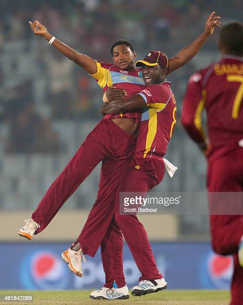 Krishmar Santokie is congratulated by Darren Sammy of the West Indies after dismissing Ahmed Shehzad of Pakistan during the ICC World Twenty20...