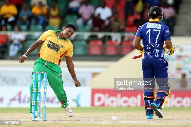 Krishmar Santokie of Guyana Amazon Warriors celebrates the wicket of William Perkins during the Limacol Caribbean Premier League 2014 final match...