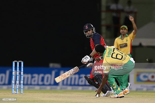 Krishmar Santokie runs out Nasir Jamshed during a match between Guyana Amazon Warriors and The Trinidad Tobago Red Steel as part of the week 2 of...