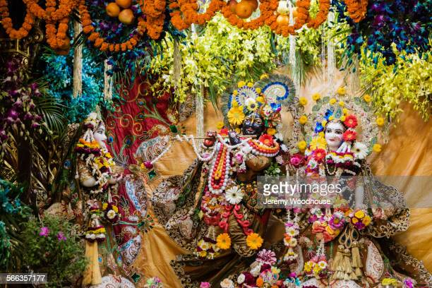 krishna and radha statues decorated in hindu temple - lord krishna stock photos and pictures