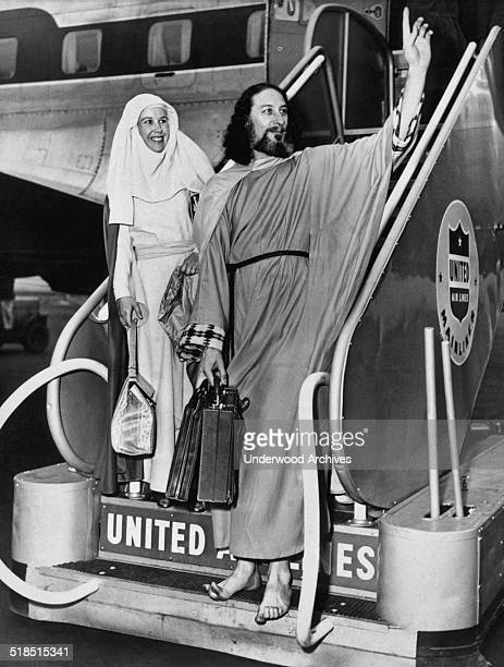 Krishna Venta known as 'The Voice' arrives at LaGuardia Field with his wife Ruth on their way to London for a series of lectures New York New York...