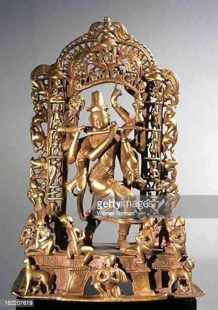 Krishna Venugopala framed by a tarana with the columns made up of avatars of Vishnu Seated musicians accompany the god while at the base sits Garuda...