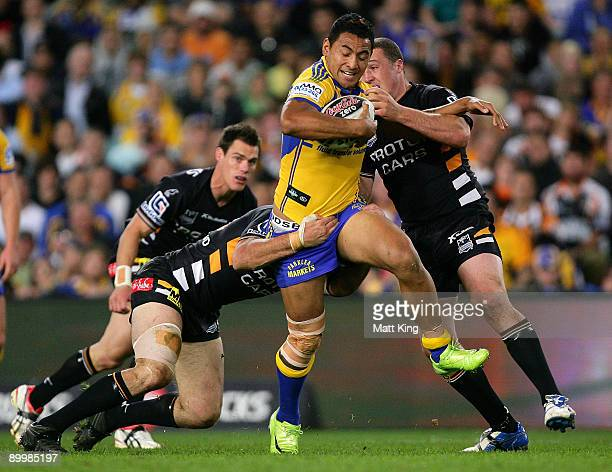 Krisnan Inu of the Eels takes on the defence during the round 24 NRL match between the Wests Tigers and the Parramatta Eels at the Sydney Football...