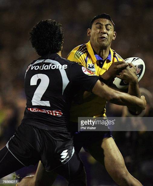 Krisnan Inu of the Parramatta Eels is stopped by Patrick Ah Van of the Warriors during the NRL qualifying final match between the Warriors and the...