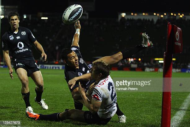 Krisnan Inu of the Warriors competes with Ashley Graham of the Cowboys in the air during the round 26 NRL match between the New Zealand Warriors and...