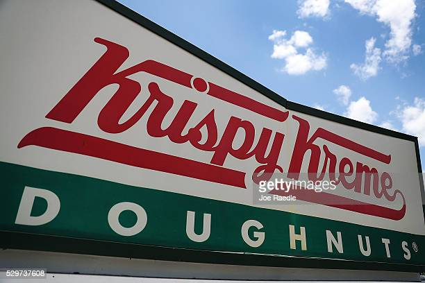 Krispy Kreme Donuts sign is seen outside of a store on May 09, 2016 in Miami, Florida. JAB Holdings Company, announced it is acquiring Krispy Kreme...