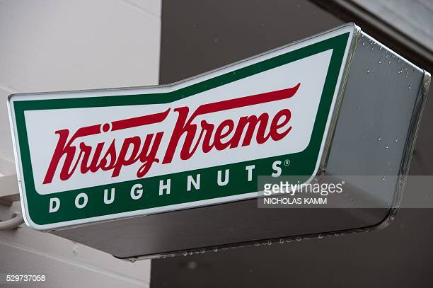 Krispy Kreme doughnut shop sign is seen in Washington, DC, on May 9, 2016. US doughnut chain Krispy Kreme is being bought by the German investment...