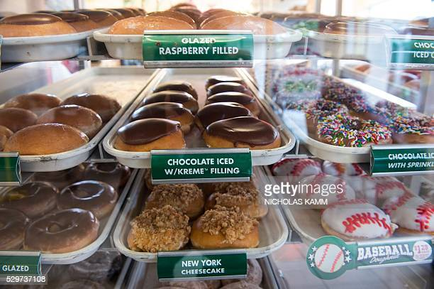 Krispy Kreme doughnuts are displayed in a shop in Washington, DC, on May 9, 2016. US doughnut chain Krispy Kreme is being bought by the German...