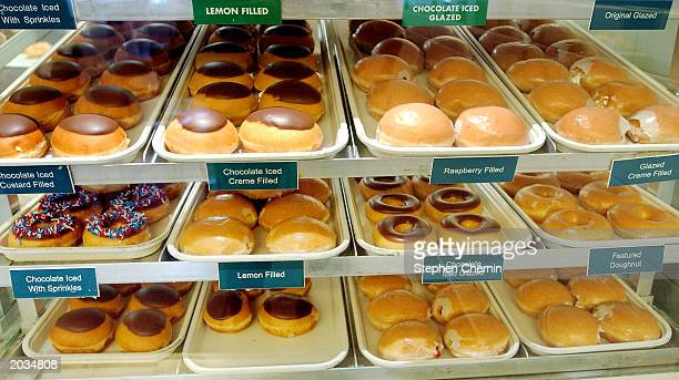 Krispy Kreme doughnuts are displayed in the front counter of a Krispy Kreme outlet May 28 2003 in New York City Increased sales and higher prices at...