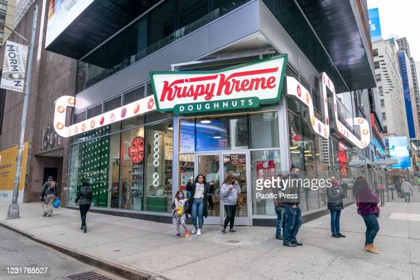 Krispy Kreme flagship store on Times Square is one of the location where fans can get free Green Donuts for St. Patrick's Day celebration. Customers...