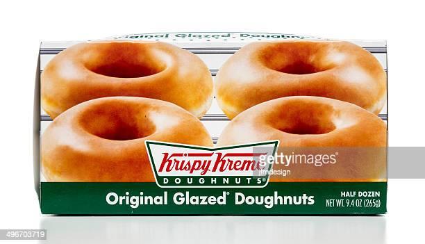 krispy kreme original glazed doughnuts - krispy kreme doughnuts stock pictures, royalty-free photos & images