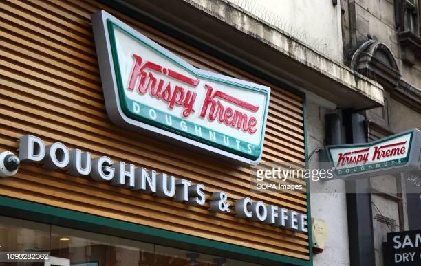Krispy Kreme store and brand logo seen in London UK