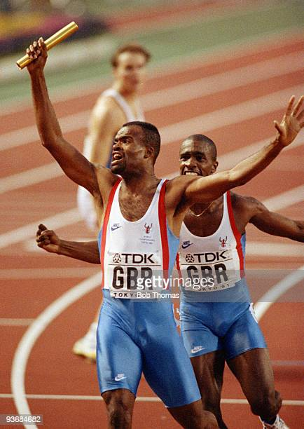 Kriss Akabusi and Derek Redmond of Great Britain celebrate victory in the men's 4x400m relay at the 3rd World Athletics Championships held at the...