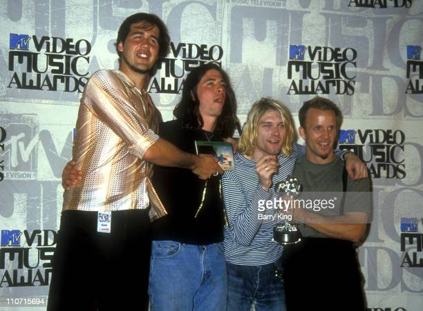 Krist Novoselic, Dave Grohl and Kurt Cobain of Nirvana and guest