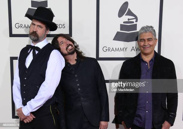 Krist Novoselic, Dave Grohl, and Pat Smear arrive at the 56th Annual GRAMMY Awards at Staples Center on January 26, 2014 in Los Angeles, California.