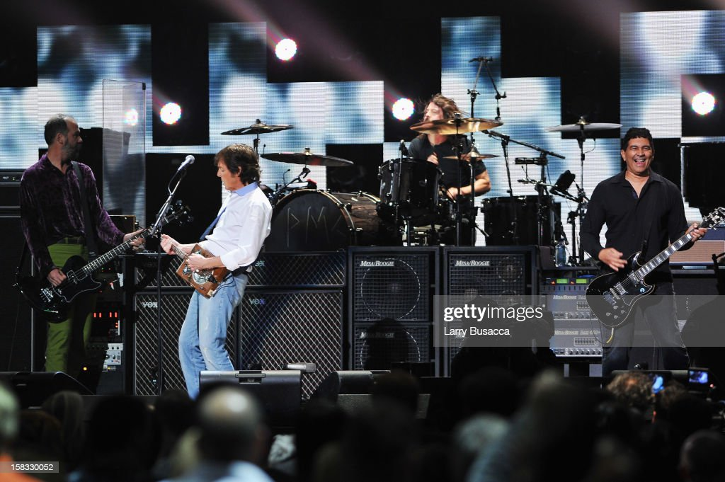 Krist Novoselic, Sir Paul McCartney, Dave Grohl, and Pat Smear perform at '12-12-12' a concert benefiting The Robin Hood Relief Fund to aid the victims of Hurricane Sandy presented by Clear Channel Media & Entertainment, The Madison Square Garden Company and The Weinstein Company at Madison Square Garden on December 12, 2012 in New York City.