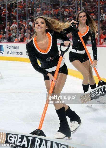 Krista Allysse Cipollone and Kristen Mee of the Philadelphia Flyers ice girls clean the ice during a timeout against the Nashville Predators on...