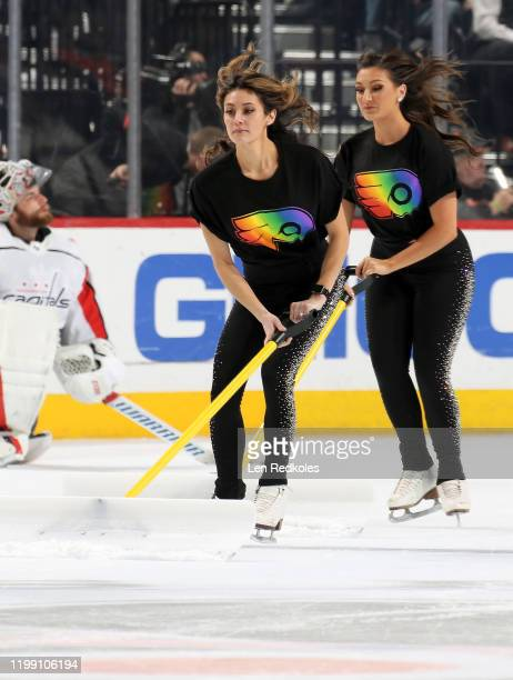 Krista Allysse Cipollone and Lexi Lord of the Philadelphia Flyers ice girls clean the ice during a timeout against the Washington Capitals on January...