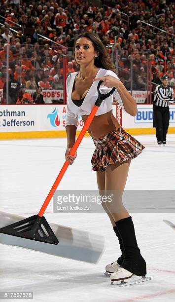 Krista Allysse Cipollone of the Philadelphia Flyers ice girls cleans the ice during a timeout against the Pittsburgh Penguins on March 19 2016 at the...