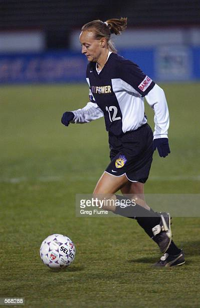 Krista Davey of the New York Power dribbles the ball against the Boston Breakers during the WUSA game in Richmond Virginia on March 23 2002 The...