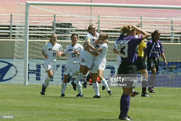 Krista Davey of the New York Power hugs Tiffeny Milbrett after one of Milbrett's three goals during the WUSA match on June 15 2002 against the San...