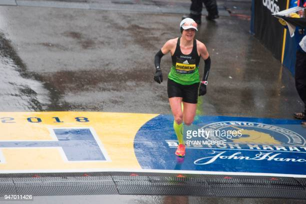 Krista Duchene of Canada crosses the finish line in third place for the 2018 and 122nd Boston Marathon for Elite Women's race with a time of 24420 on...