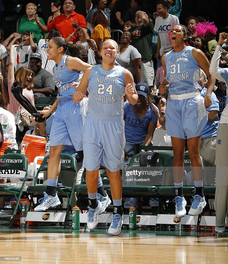 Krista Gross #21, Whitney Adams #24, and Erika Johnson #31 of the North Carolina Tar Heels react as a last second shot scores to defeat the Miami Hurricanes on January 27, 2013 at the BankUnited Center in Coral Gables, Florida. The Tar heels defeated the hurricanes 64-62.