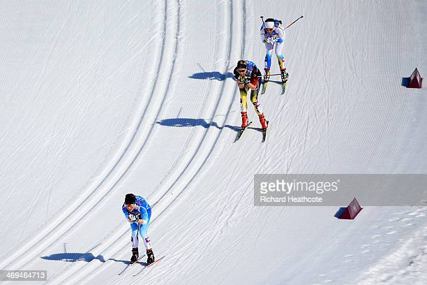 Krista Lahteenmaki of Finland takes lead to Denise Herrmann of Germany and Charlotte Kalla of Sweden on the fourth leg in the Women's 4 x 5 km Relay...
