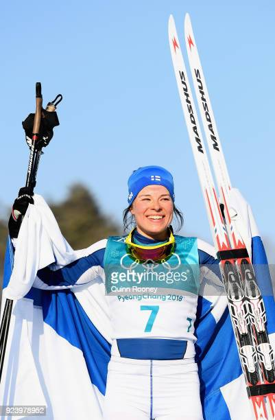 Krista Parmakoski of Finland celebrates finishing second during the Ladies' 30km Mass Start Classic on day sixteen of the PyeongChang 2018 Winter...
