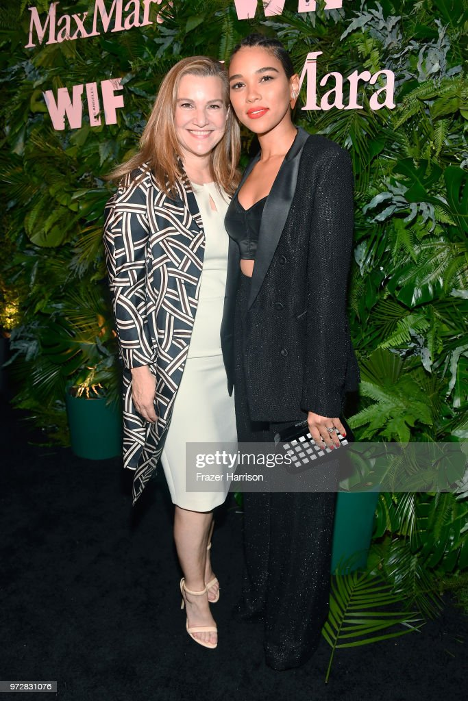 Krista Smith (L) and Alexandra Shipp, wearing Max Mara, attend the Max Mara Celebration for Alexandra Shipp, 2018 Women In Film Max Mara Face Of The Future Award Recipient at Chateau Marmont on June 12, 2018 in Los Angeles, California.