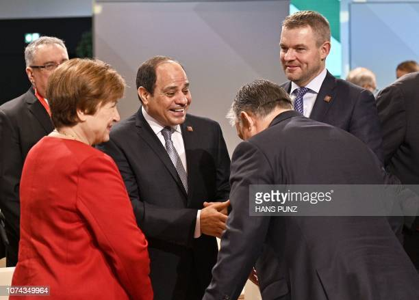 Kristalina Georgieva CEO of the World Bank and Slovakia's Prime Minister Peter Pellegrini look on as Egypt's President Abdel Fattah ElSisi shakes...
