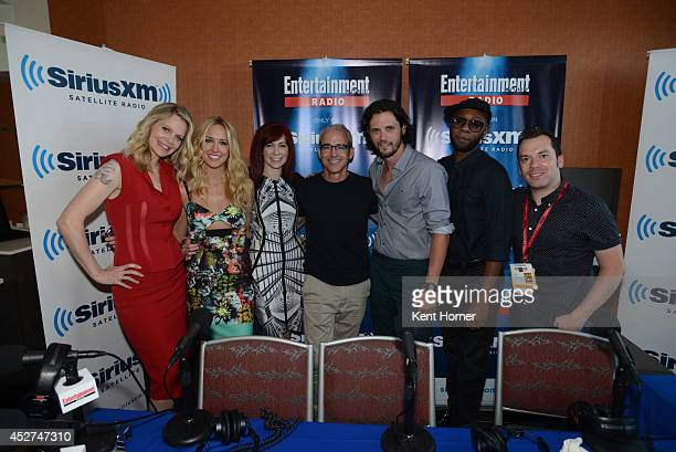 Kristan Bauer van Straten Anna Camp Carrie Preston Jess Cagle Nathan Parsons and Nelsan Ellis pose with radio host Tim Stack after being interviewed...