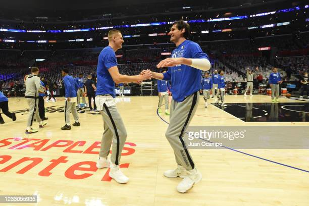 Kristaps Porzingis and Boban Marjanovic of the Dallas Mavericks shake hands before the game against the LA Clippers during Round 1, Game 1 of the the...