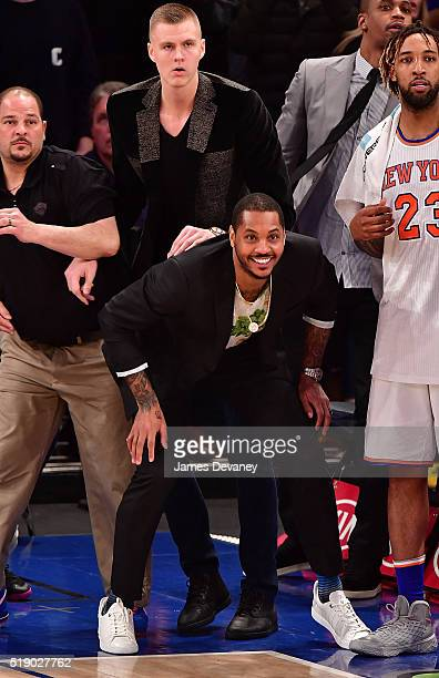 Kristaps Porzingis and Carmelo Anthony attend the Indiana Pacers vs New York Knicks game at Madison Square Garden on April 3 2016 in New York City