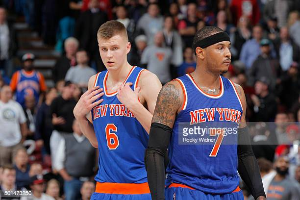 Kristaps Porzingis and Carmelo Anthony of the New York Knicks look on during the game against the Sacramento Kings on December 10 2015 at Sleep Train...