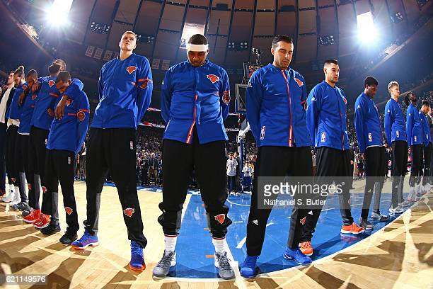 Kristaps Porzingis and Carmelo Anthony of the New York Knicks stand on the court for the National Anthem before the game against the Memphis...